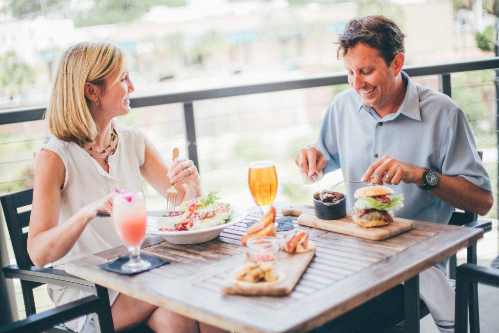 man and woman dining al fresco at the edison tallahassee