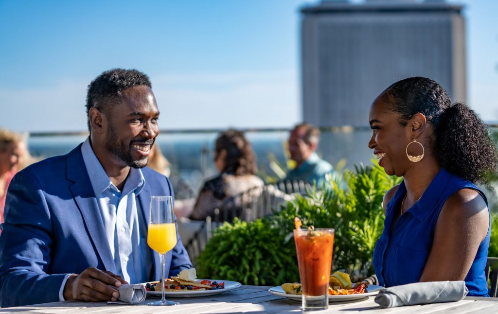 African American couple happy hour at Eve on Adams