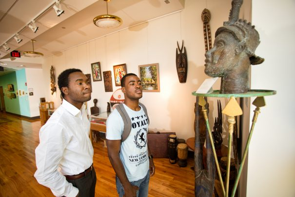 two men looking at art in the black archives ats famu