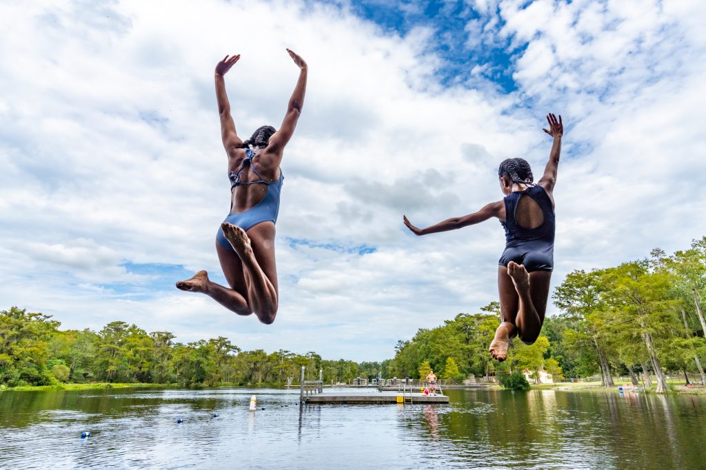 two girls jump into wakulla springs