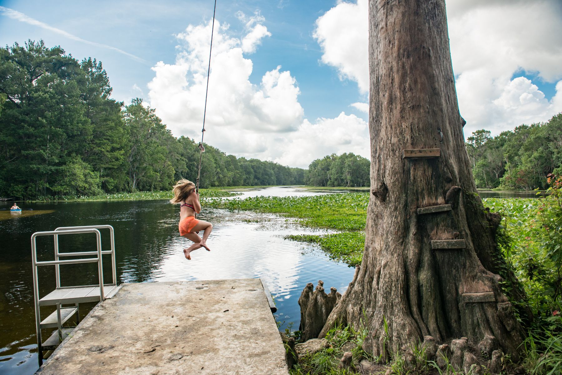 Girl on the rope swing at the wacissa river